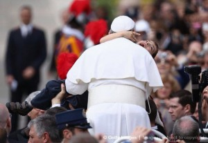 Pope Francis hugs Dominic Gondreau at Easter Mass.