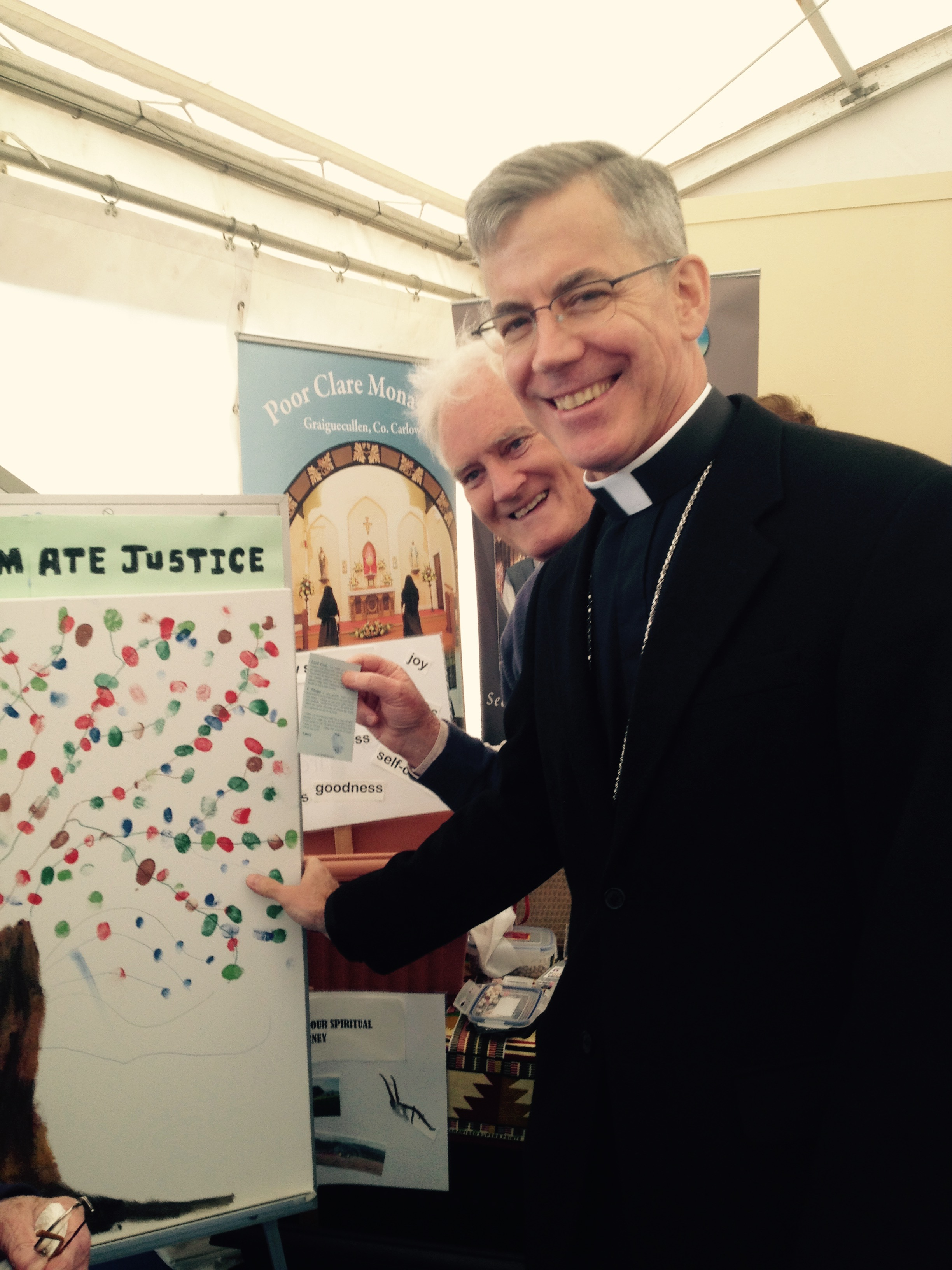 His Excellency Archbishop Charles Brown adds his mark to the SMA thumbprint campaign