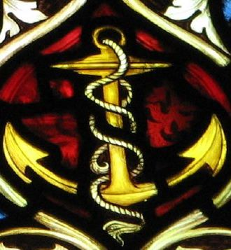 photograph of a stained glass image of an anchor, Saint Michael's church, Oxford, England; swiped with permission from the flickr account of Brother Lawrence Lew, OP