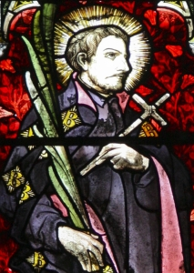 detail of a stained glass window of Saint Alexander Briant in the church of Our Lady and the English Martyrs in Cambridge, England; swiped with permission from the flickr.com site of Brother Lawrence Lew, OP