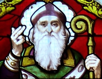 detail of photograph of a late 19th century stained glass window of Saint Anatolius of Milan, church of Ablis, Yvelines, France, artist unknown; photograph by Guillaume Piolle, 27 September 2008; swiped off Wikipedia