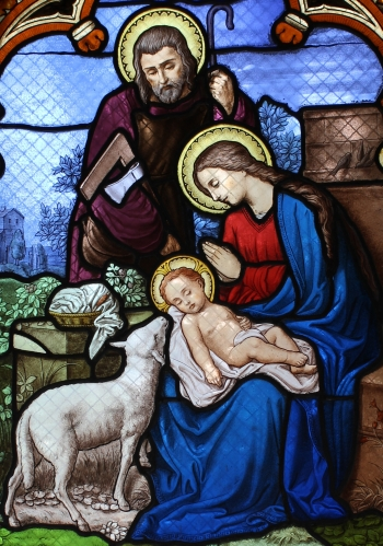 detail of a stained glass window of the Holy Family; by L. Collinet, year unknown; funeral chapel, tomb of André Corréa Mendès, Père Lachaise Cemetery, Paris, France; swiped from Wikimedia Commons