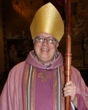 The Most Reverend Joseph R Binzer, Roman Catholic auxiliary bishop of Cincinnati, Ohio, vested in rose-coloured chasuble for Laetare Sunday; swiped from Wikipedia
