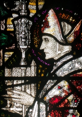 detail, depicting Saint Aidan, of a stained glass window titled 'The Maddona with Saints Aidan and Adrian', by Harry Clarke; Church of the Assumption, Wexford, County Wexford, Ireland; photographed on 29 September 2010 by Andreas F Borchert; swiped off Wikimedia Commons