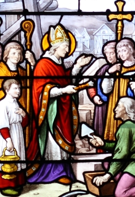 stained glass window of Saint Aignan of Orléans giving the blessed to laying the cornerstone of the parish church, artist unknown, date unknown; Saint Aignan Church, Chartres, France; photographed on 21 January 2011 by Reinhardhauke; swiped from Wikimedia Commons