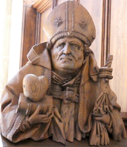 wooden sculpture of Saint Augustine in the southern choir stalls in Halle Cathedral, Saxony-Anhalt, Germany; date and artist unknown; photographed on 3 July 2008 by Catatine; swiped from Wikimedia Commons