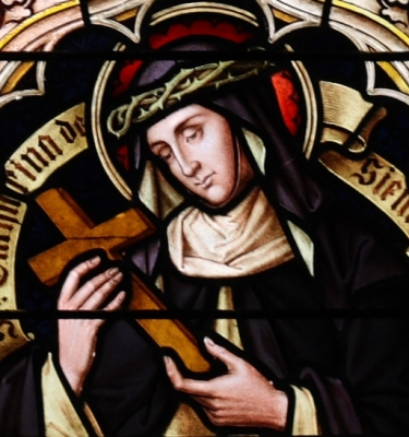 detail of a stained glass window of Saint Catherine of Siena, church of Saint Kilian, Lechenich, Germany; date unknown, artist unknown; photographed on 16 April 2011 by Reinhardhauke; swiped from Wikimedia Commons