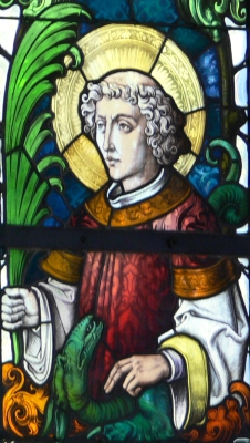detail of a stained glass window of Saint Cyriacus, parish church of Saint Pelagius, Weitnau, Germany; date unknown, artist unknown; photographed on September 2007 by Andreas Praefcke; swiped from Wikimedia Commons