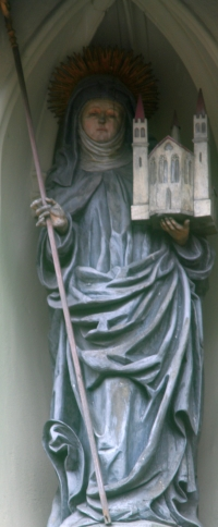 statue of Saint Erentrudis; date unknown, artist unknown; portal of the Nonnberg Abbey, Salzburg, Austria; photographed on 7 May 2007, photographer unknown; swiped from Wikimedia Commons