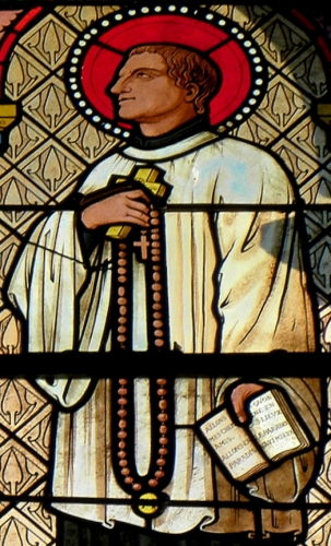 detail of a stained glass window of Saint Louis-Marie Grignion de Montfort, Church of Saint-Pierre de Melesse; date and artist unknown; photographed on 7 December 2013 by GO69; swiped from Wikimedia Commons