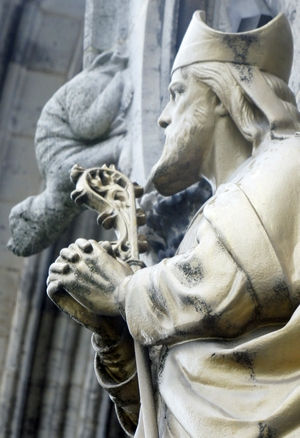 detail of a statue of Saint Loup of Troyes; date and artist unknown; front door of the Church of Saint Loup, Chalons-en-Champagne, France; photographed on 16 September 2012 by G. Garitan; swiped from Wikimedia Commons