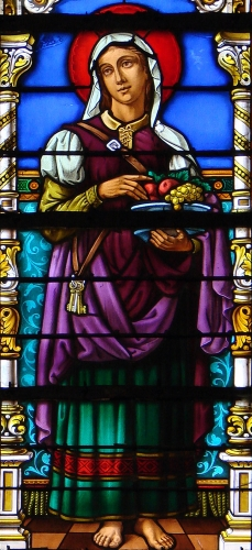 detail of a stained glass window of Saint Martha of Bethany; date and artist unknown; Saint-Michel abbey church, Saint-Mihiel, France; photographed on 30 November 2008 by Vassil; swiped from Wikimedia Commons
