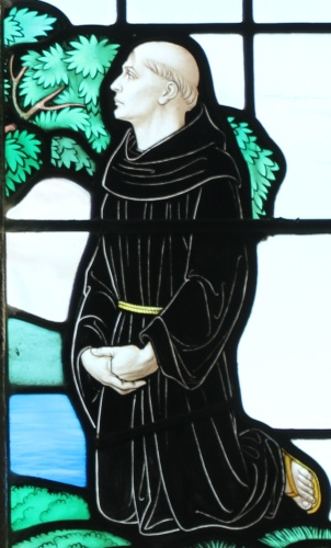 detail of a stained glass window of Saint Tudwal of Tréguier listening to Saint Mawes; date and artist unknown; photographed on 2 October 2015 by Andrewrabbott; swiped from Wikimedia Commons