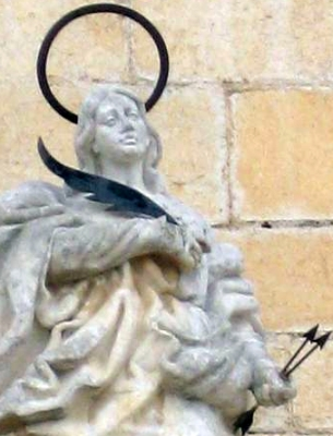 photograph of a statue of Saint Victoria, date unknown, artist unknown; in the front of the church of Saint John the Baptist, Alcalà de Xivert, Spain; swiped off Wikimedia Commons