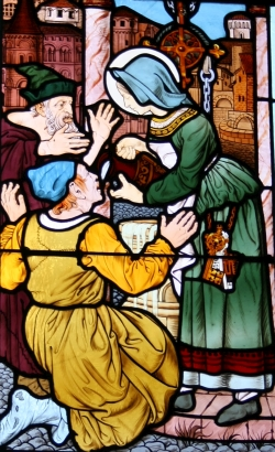 detail of a stained glass window depicting Saint Zita of Lucca; design by Raphaël Freida, manufacture by Félix Gaudin, date unknown; Church of Saint-Honoré d'Eylau, Avenue Raymond Poincaré, 16th arrondissement of Paris, France; photographed on 12 September 2010 by GFreihalter; swiped from Wikimedia Commons