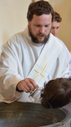 a deacon baptizing
