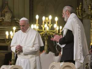 Pope Francis listens as Rabbi Riccardo Di Segni, the chief rabbi of Rome, outlines his demands during the pope's visit to the main synagogue in Rome January, 17