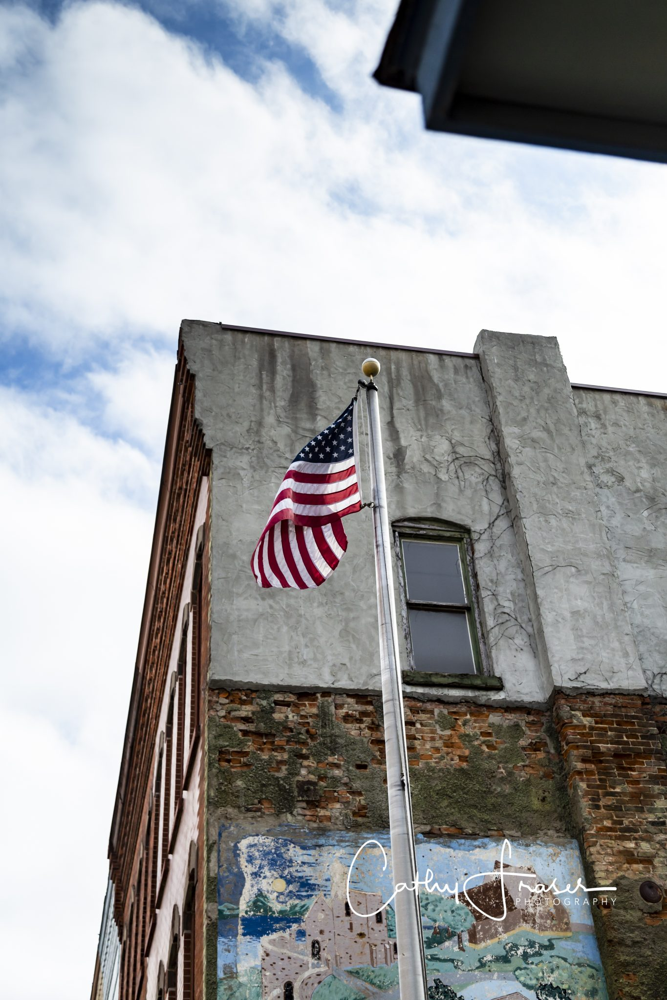 Landscape Photography of a flag in front of a building in Penn Yan New York