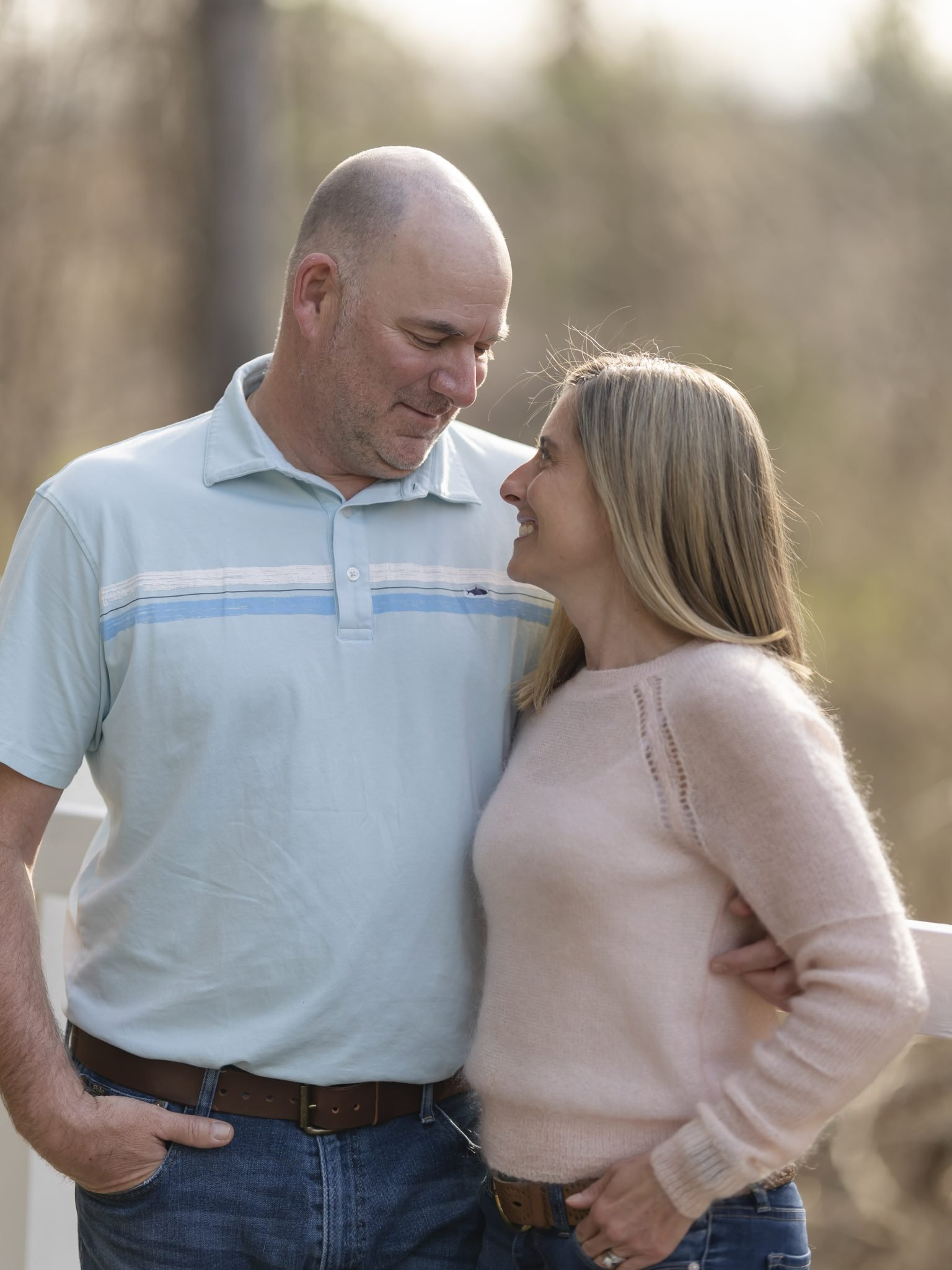 Husband and wife in pink sweater, blue polo and jeans, natural lighting, natural setting, woods, Professional portraits, couples portraiture, Keuka Lake, Fingerlakes Region, Vacation photos, Fingerlakes vacation, Penn Yan, New York, family photoshoot, family pictures, Husband and wife pictures, happiness, love