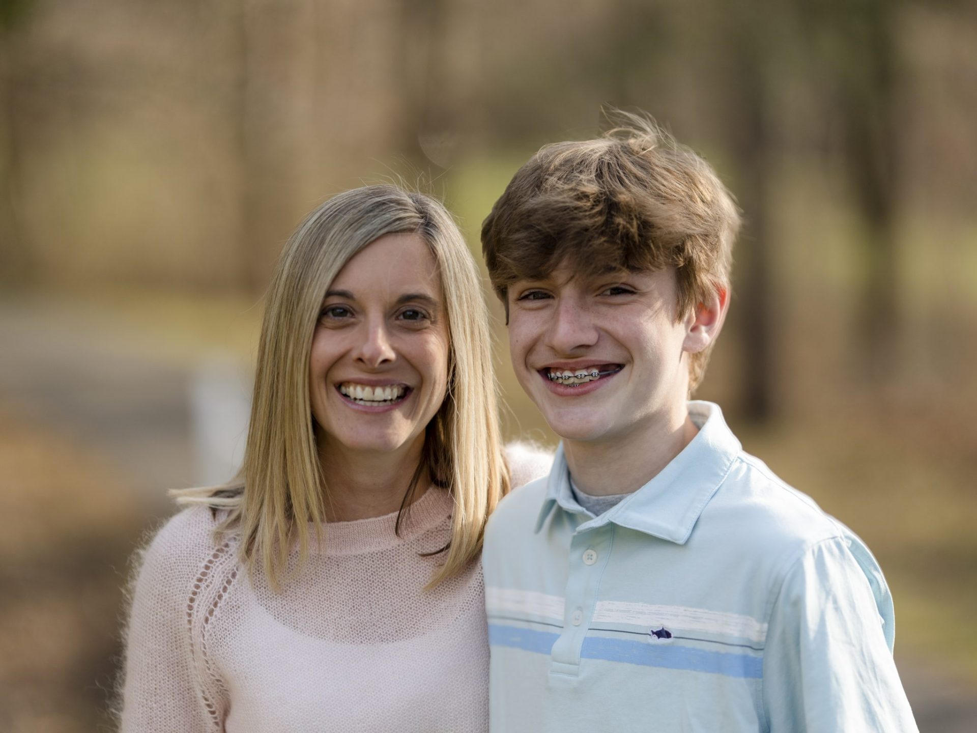 Mother and son in pink sweater, blue polo and jeans, natural lighting, natural setting, woods, Professional portraits, portraiture, Keuka Lake, Fingerlakes Region, Vacation photos, Fingerlakes vacation, Penn Yan, New York, family photoshoot, family pictures, Mom and son pictures