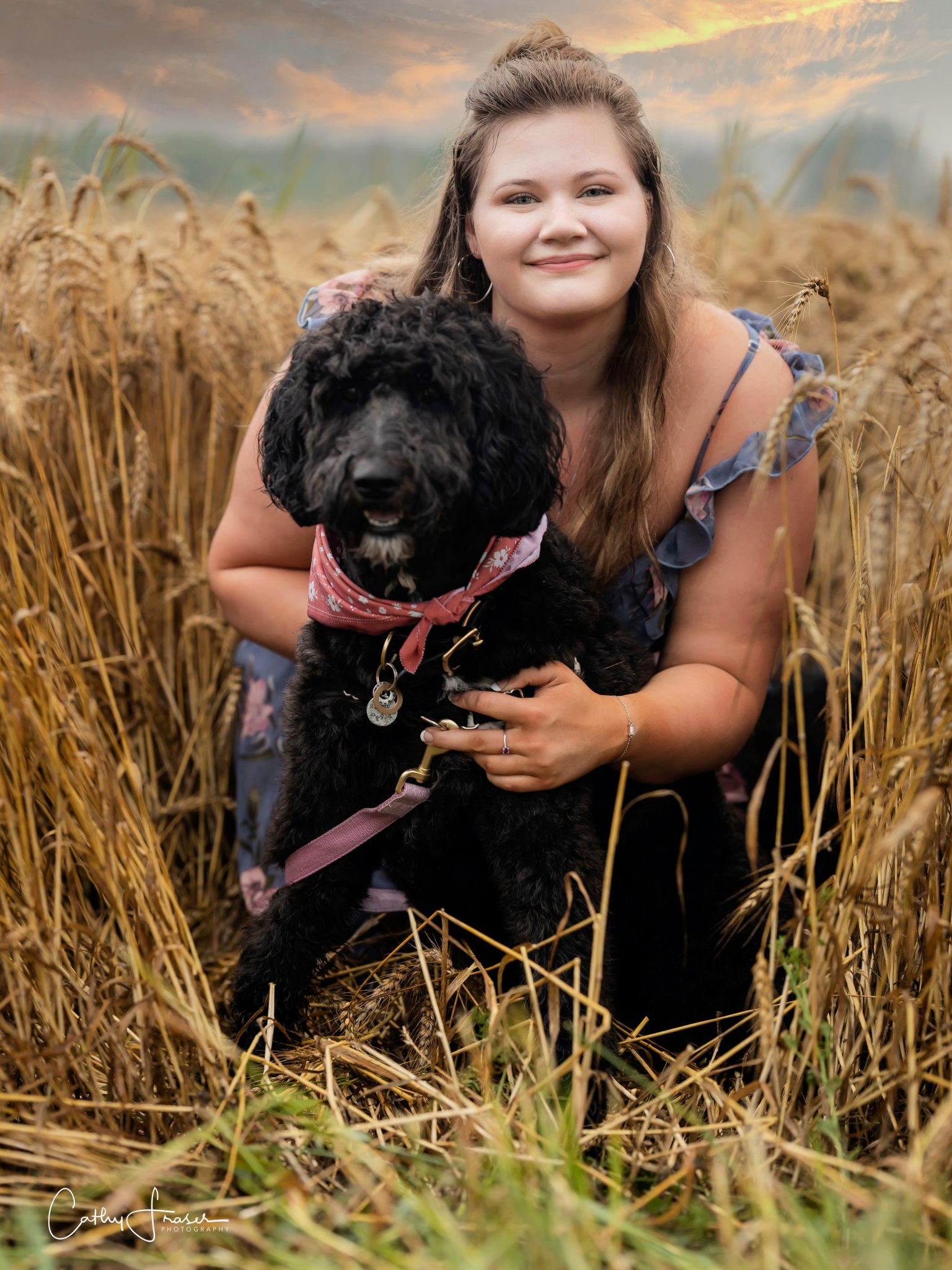 Girl and dog standing in a wheat field, long blue floral dress, natural light, portraits, professional portraits, Hilton, NY, Senior Girl pictures, pictures with a pet, image of girl and her dog