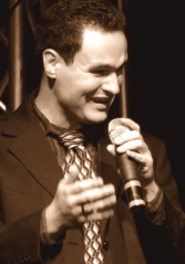Miles holds the microphone and enjoys interacting with congregations as he sings.