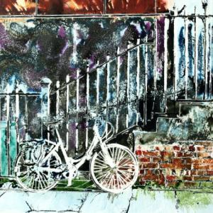 Urban art inspiration in a painting of a White bicycle glowing in the sunlight propped up against railings in Manchester. White Bicycle- ©2015 - Cathy Read -Watercolour and Acrylic - 40 x 50 cm