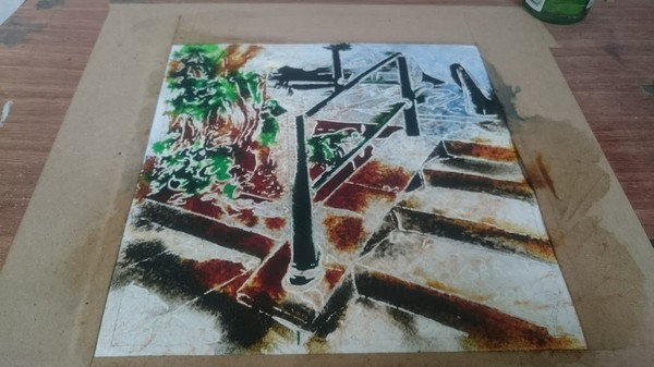 Painting in progress of a handrail and steps.