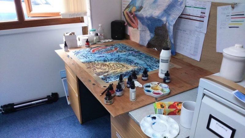 Painting inprogress of Big Ben, underground sign and London Map