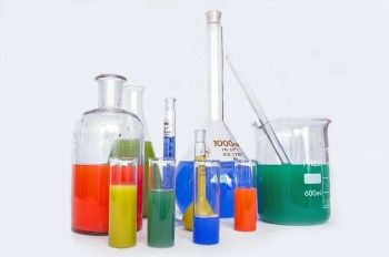 Lab beakers for testing chemical ingredients in flea products