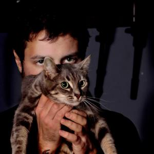 Mike and Vivian, one of his studio cats.