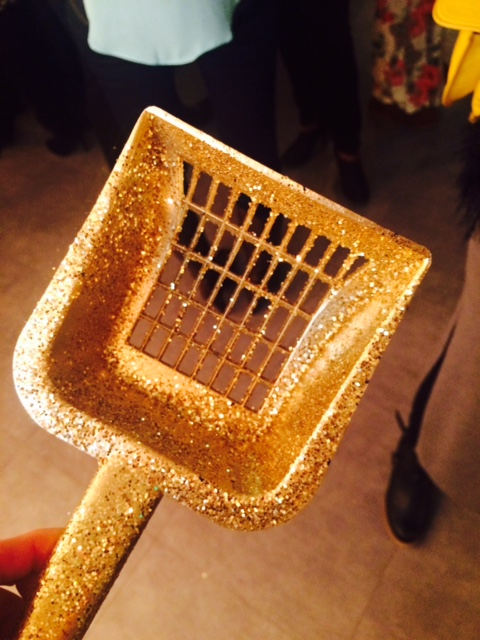 The golden scoop. (it's plastic with glitter on it.)