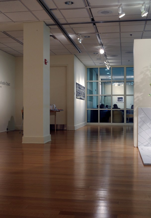 """""""Pave Paradise"""" Installed at Stamp Gallery, UMD-College Park. 5′ x 6′ x1′ Floor, 5′ x 3′ x 1′ Wall. Plywood, MDF, conversion varnish, artificial tree."""