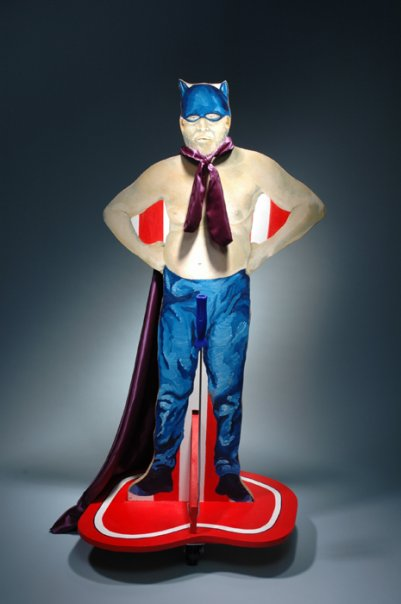 """""""Rent-A-Retired-Superhero"""" 3/4 scale on casters with pull handle."""