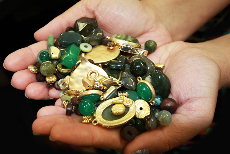 A variety of beautiful beads in two hands