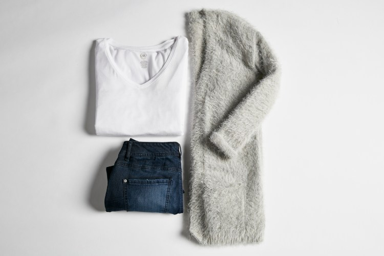 Perfect Layers. A lay down shot of a white t-shirt, jeans and a cozy cardigan