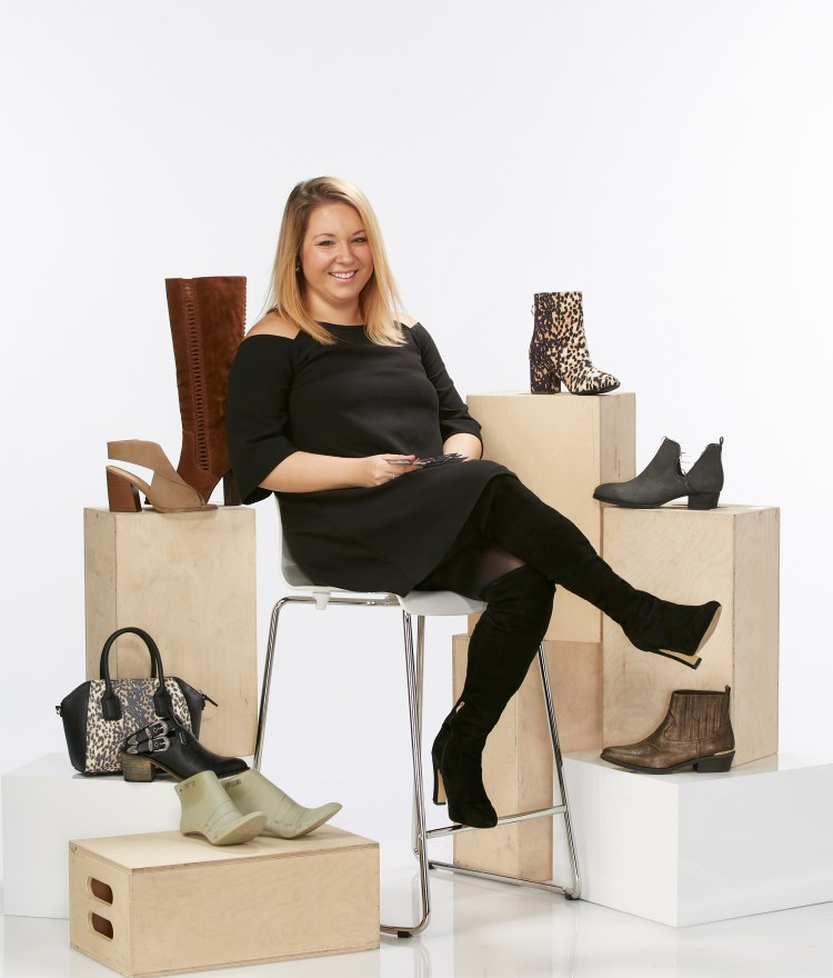 Meet the Cato Designer: Jenna. Jenna pictured in front of a variety of boots and handbags.