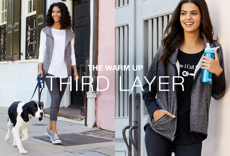 The Warm Up Third Layer. Two women enjoying the outdoors. One has an activewear jacket on and the other an activewear vest.