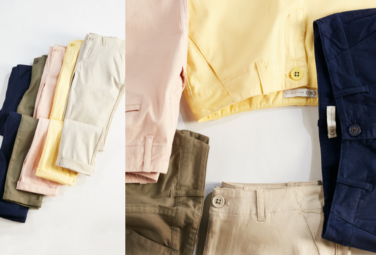 A variety of chino pants in different colors.