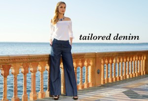 Tailored Denim. A beautiful young woman wearing a white top and dark wash wide leg jeans.