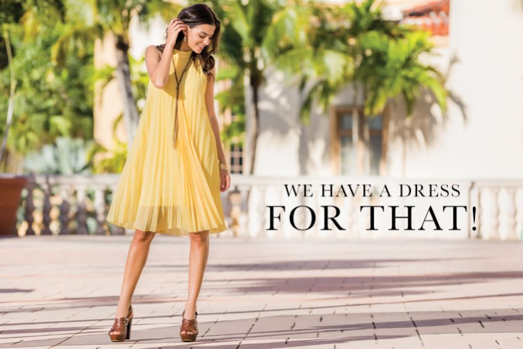 We Have A Dress for That! Model wearing yellow pleated swing dress