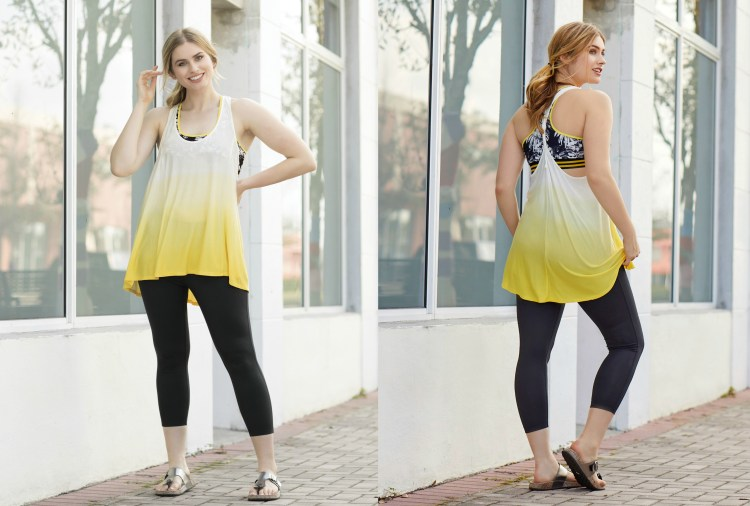 Model wearing yellow athleisure top and black leggings
