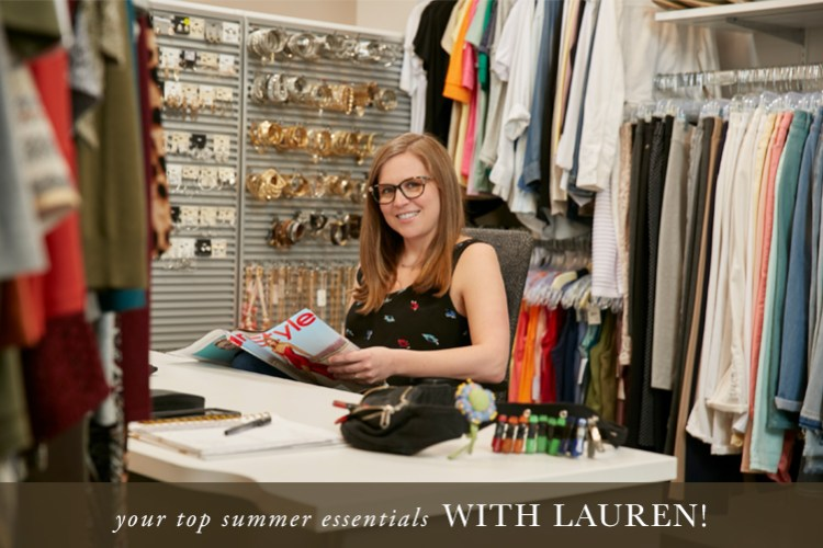 Your Top Summer Essentials with Lauren! Picture of Lauren at her desk surrounded by clothing.