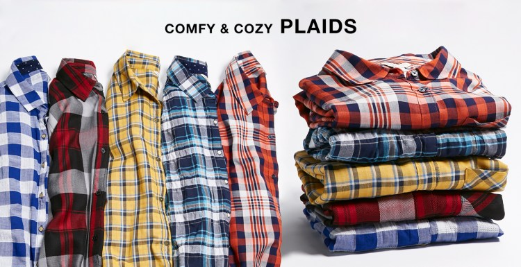 "Stacks of plaid shirts with the caption, ""Comfy and cozy plaids."""