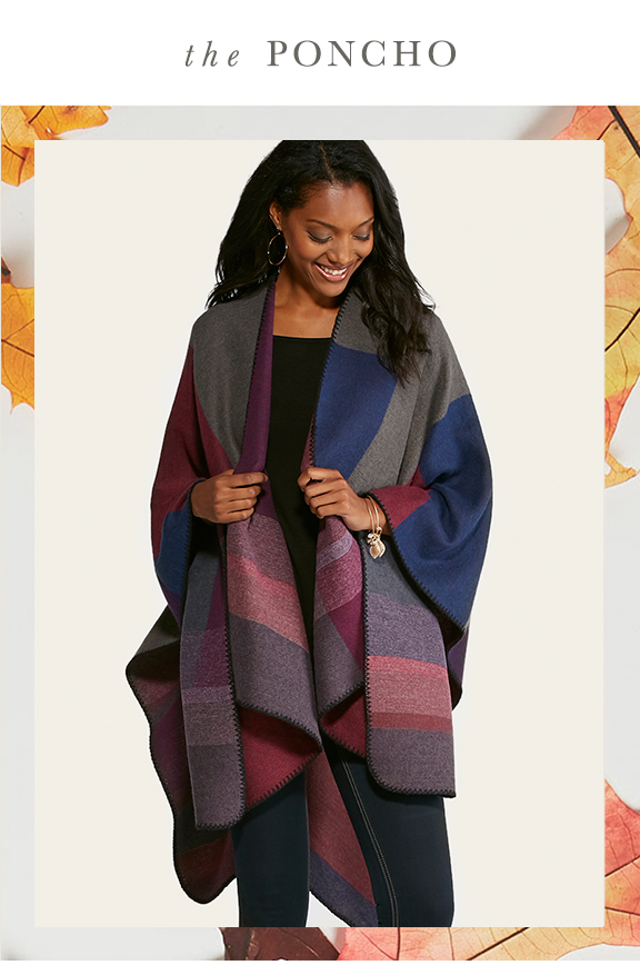 The Poncho. A woman looking happy in an oversize poncho