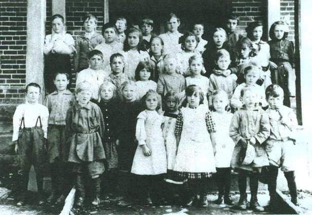 Leah Van Houtte, top row on right Amos Van Houtte, front row, second on left John Van Houtte, front row, second on left