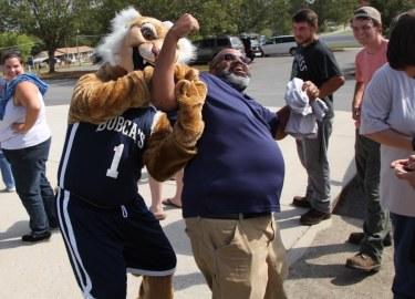 Shredder helps GNTC staffer Vince Stalling flex the guns on a hot September day during Welcome Week!