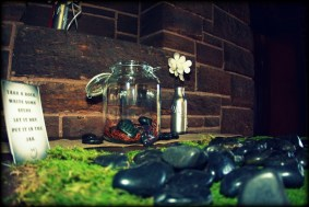 River rocks and a jar for the guestbook.