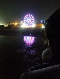 Pathfinder looking out at the carnival on Old Orchard Beach.