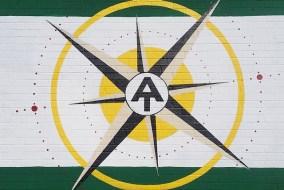 AT symbol on building